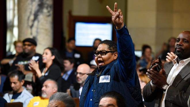 Donnie Anderson, co-founder and chairman of the California Minority Alliance, reacts after the Los Angeles City Council voted unanimously to approve new regulations for the marijuana industry on Wednesday, Dec. 6, 2017, in Los Angeles.