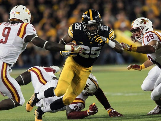 Iowa running back Akrum Wadley touched the football