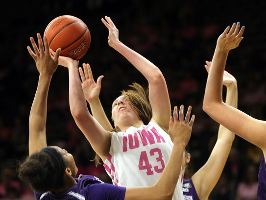Iowa's Amanda Ollinger takes a contested shot during
