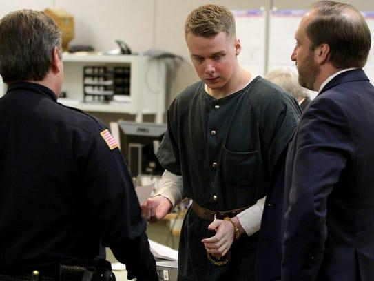 Liam McAtasney prepares to leave State Superior Court