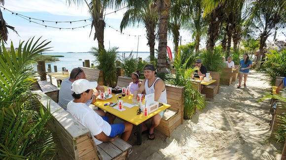 Paradise Grill, located on Indian River Bay in the Pot Nets Bayside community off of Long Neck Road near Millsboro, features open-air dining.