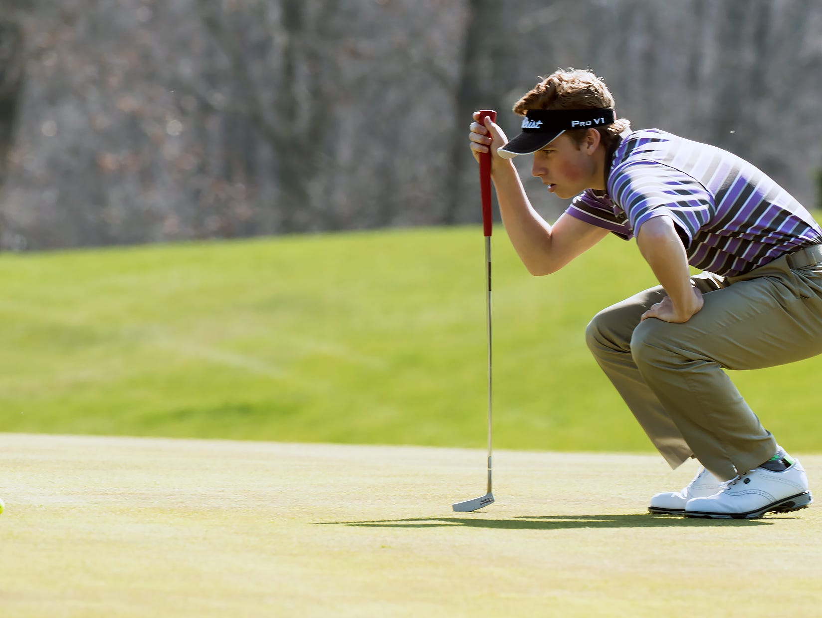 Lakeview's James Staab checks the lay of the green as he prepares to putt on the 10th hole early in the Lakeview Jamboree held at Cedar Creek golf course Thursday afternoon.