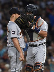 Tigers catcher James McCann (34) talks with pitcher