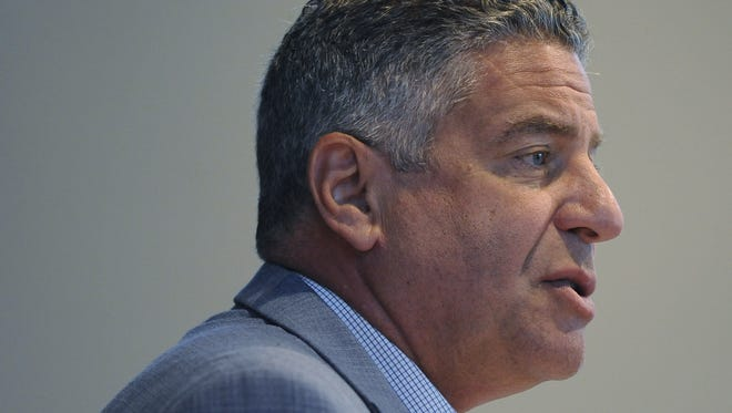 Auburn basketball coach Bruce Pearl speaks at a Public Safety Insurance Fund awards banquet at the RSA Activity Center in downtown Montgomery, Ala. on Thursday July 10, 2014.