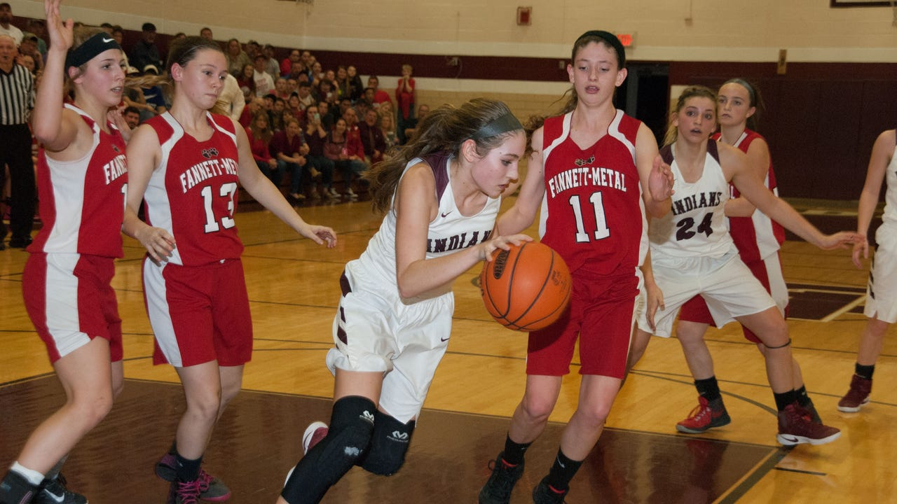 Southern Fulton's Lindsey Hollenshead (center) moves