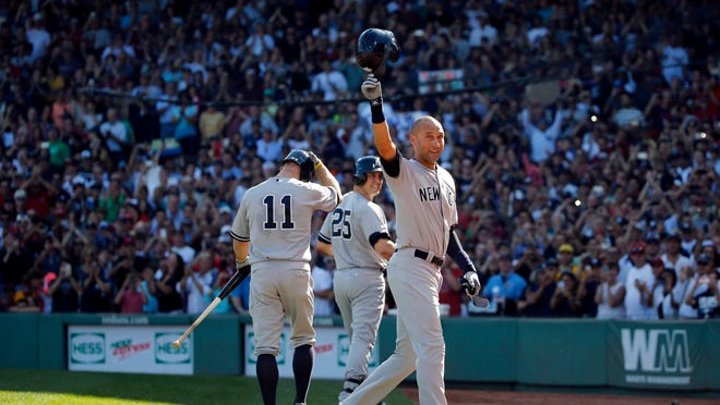 Derek Jeter tips his cap to the crowd at Fenway Park after coming out of the game for a pinch-runner in the third inning against the Boston Red Sox.
