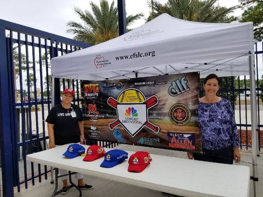 Education Foundation, St. Lucie Office Manager Diane Todman, left, and Lisa Paparella, program danager, work the tent at First Data Field during the All-Star Softball Game.