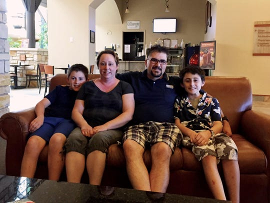 Teigh Fleury, second from right, sits with his family