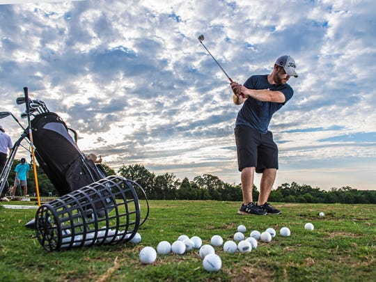 Michael Green hits a bucket of balls at Shanks Driving Range in Greenville on Tuesday, June 28, 2016.