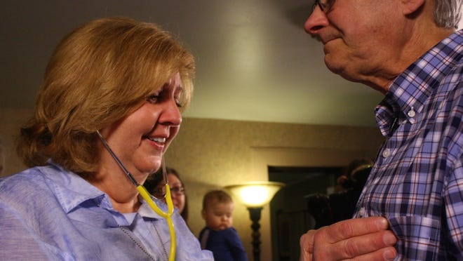 Debbie Wieland listens to her son Richard's heart inside Claude Brown in Rochester Saturday.