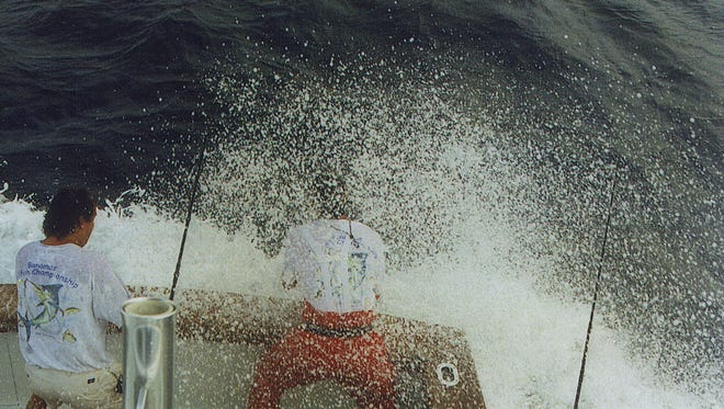 Are you ready for some sailfish? Angler T.J. Heinemann (right) of Palm City and first mate Randy Zaleski (left) prepare to release a sailfish aboard Heinemann's boat Katie M during a 1996 sailfish tournament off the Treasure Coast.