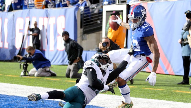 New York Giants wide receiver Odell Beckham Jr. (13) catches a touchdown pass against Philadelphia Eagles corner back Leodis McKelvin (21) during the second quarter at MetLife Stadium.