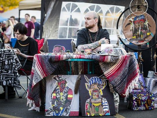 Vendors sell art on Charles Street in downtown Muncie