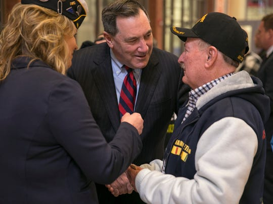 Senator Joe Donnelly (middle), speaks with Vietnam