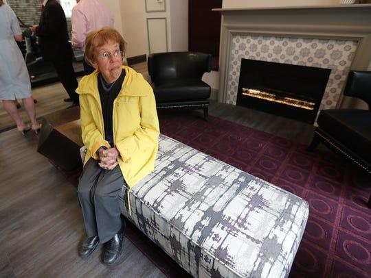 Chappaqua Crossing resident Ginny Enright, 85, sits
