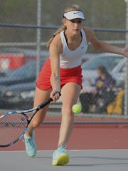 West Side's Kaluta Emilka battles in singles competition during the Hoosier Conference Girl's Tennis Tournament Tuesday at the Cumberland tennis courts.