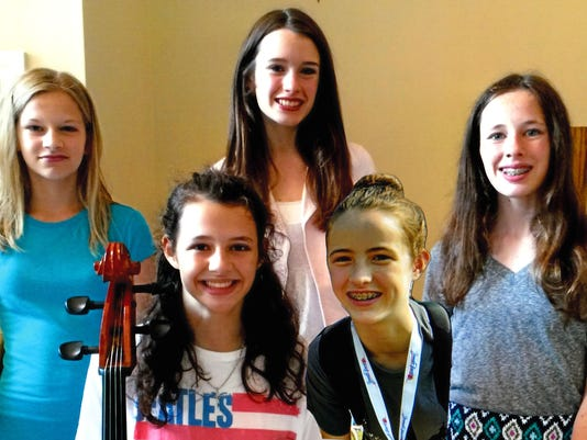 NRO 1 Group of girls work to get orchestra in schools