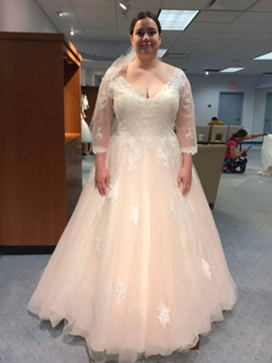 a0450ad55b3f6 636357426609831257-untitled-1500156301925-10058447-ver1.0.png. Anna  Wilkowski tries on wedding dress at Alfred Angelo Bridal.