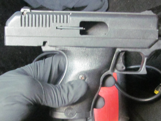 A handgun was seized during the execution of a search