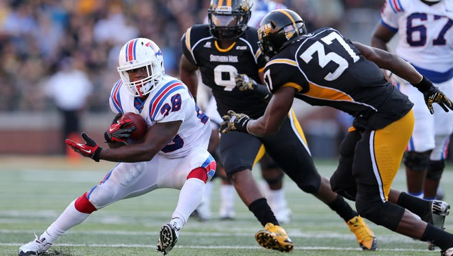 Louisiana Tech running back Kenneth Dixon was a threat out of the backfield in last year's meeting with Southern Miss, catching six passes and two touchdowns.