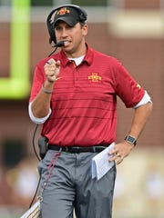 Iowa State head coach Matt Campbell walks in the first quarter against the Akron Zips at InfoCision Stadium in Akron, Ohio, on Sept. 16, 2017.