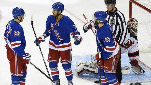 From left to right, the Rangers' Pavel Buchnevich,