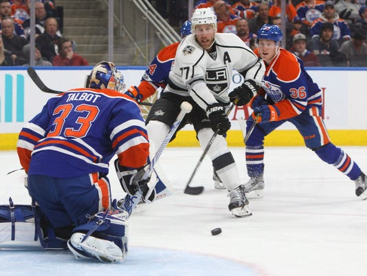 Los Angeles Kings' Jeff Carter (77) is stopped by Edmonton Oilers' goalie Cam Talbot (33) as Drake Caggiula (36) defends during the third period of an NHL hockey game in Edmonton, Alberta, Tuesday, March 28, 2017. The Oilers won, 2-1. (Jason Franson/The Canadian Press via AP)