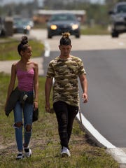 Cape Coral residents Daniela Mejias, 16, and Isaac Marina, 17, walk northbound alongside Andalusia Blvd. Monday afternoon, April 23, 2018. The city of Cape Coral approved last week adding 5 miles of new sidewalks in different areas. This will be one of the locations where construction will take place.