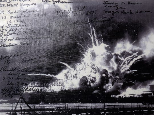 "A photo showing the Japanese attack on Pearl Harbor, belonging to World War II Army veteran Armando ""Chick"" Galella of Sleepy Hollow. Galella, now 95, is a survivor of the Japanese attack on Pearl Harbor. The photo was signed by fellow survivors of the attack."
