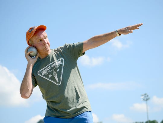 David Herbert leans back to throw the shot put during
