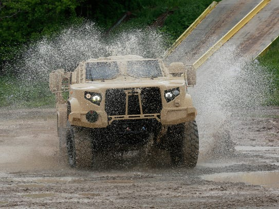 Oshkosh Corp.'s JLTV maneuvers through the test course.