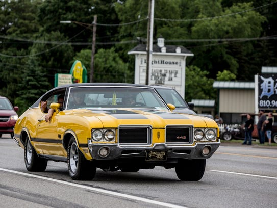 A classic car cruises during Cruise Night Friday, June