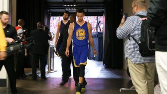 Golden State Warriors guard Stephen Curry (30) walks to the locker room after the game against the Houston Rockets in game four of the Western Conference Finals of the NBA Playoffs at Toyota Center.
