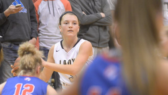 Winchester's Becca Chamberlin looks to make a pass during Winchester's 53-28 win over Union City Tuesday, Dec. 12, 2017 at Winchester Fieldhouse.