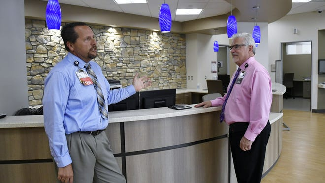 John Leal, director of Kaweah Delta's Urgent Care Clinics, and Dan Allain, assistant chief nursing officer, discuss the new Urgent Care center located in northwest Visalia.