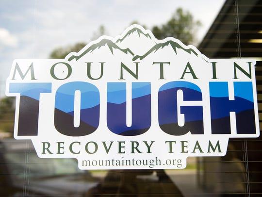 A logo marks the door of the nonprofit Mountain Tough,