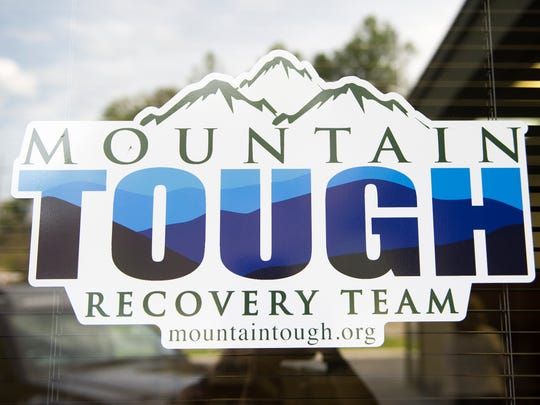 A logo marks the door of the nonprofit Mountain Tough, which is charged to help Gatlinburg wildfire survivors recover, at their office off the Parkway in Gatlinburg on Thursday, May 18, 2017.