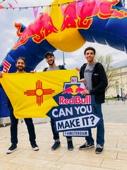 "Team Naray - Emilio Baca, Jonah Kennon and Torbyn Nare - display the New Mexico flag at the Red Bull ""Can You Make It?"" starting line in Budapest, Hungary. The team did make it to Amsterdam, Netherlands within the required seven days and finished 28th in the adventure race."