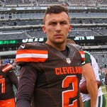 Cleveland Browns quarterback Johnny Manziel (2) walks off the field after their game against the New York Jets at MetLife Stadium.