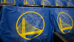 T-shirts depicting a map of the bay area and the Golden