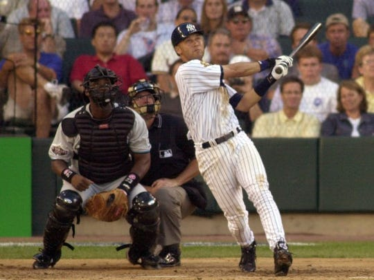 Derek Jeter watches his sixth-inning home run take flight he hit off National League pitcher Jon Lieber during the 2001 All-Star Game.