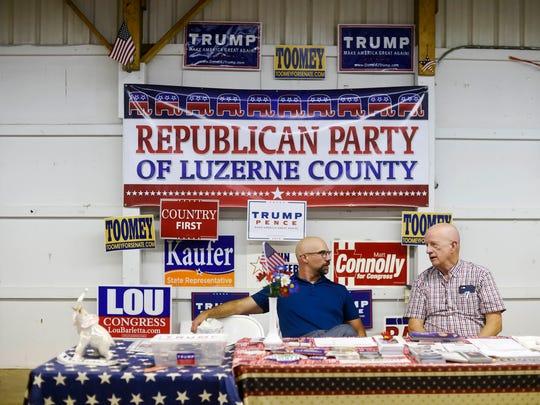 Chris Thomas, left, and Eugene Kelleher man the Republican