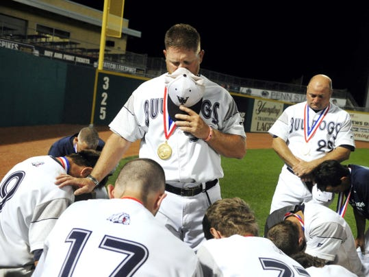 West York head baseball coach Roger Czerwinski led his team and staff in a moment of silence in the outfield in memory of family members and close friends of the team who have passed recently, before greeting West York fans after defeating Lampeter-Strasburg to win West York's first-ever state championship in baseball June 15, 2012 in State College.