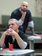 Kenton County Detention Center inmates Jesse Stewart (foreground) and Eric Taylor listen during an anger management class in the Jail Substance Abuse Program (JSAP) at the facility.