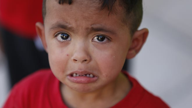 Bryan Rosales, 2, cries during a protest against the zero-tolerance immigration policy, that has led to children being separated from their parents at the border, outside the Sandra Day O'Connor Courthouse in Phoenix on June 18, 2018.