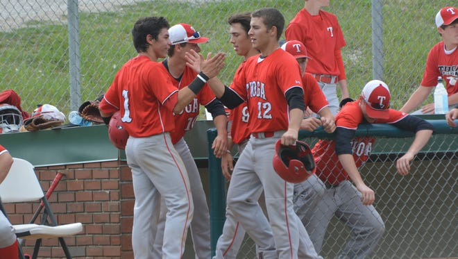 Tioga's Logan Dubois (1, left) congratulates Zach Sanders (12, right) after Sanders' hit brought in two runs against Grant Wednesday. Sanders finished 5-for-5 and drove in eight runs in the Indians' 15-3 win.