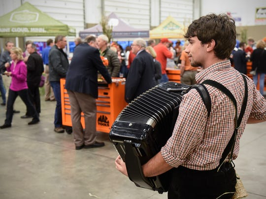 Nathan Neuman provides some festive music during the BrewLash event Thursday, Oct. 26, at St. Cloud Technical & Community College in St. Cloud.