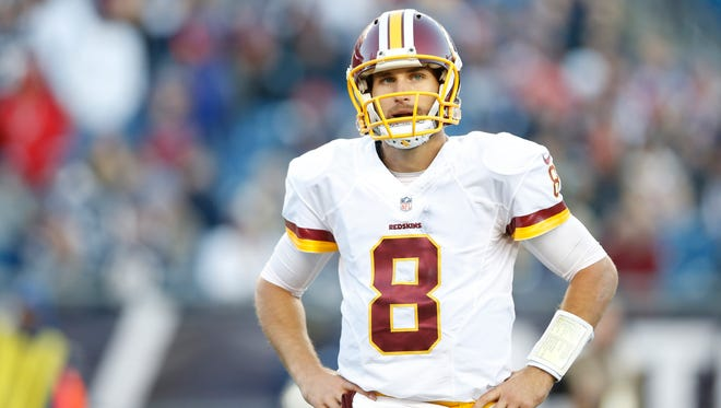 Washington Redskins quarterback Kirk Cousins (8) reacts after an incomplete pass during the fourth quarter against the New England Patriots at Gillette Stadium.