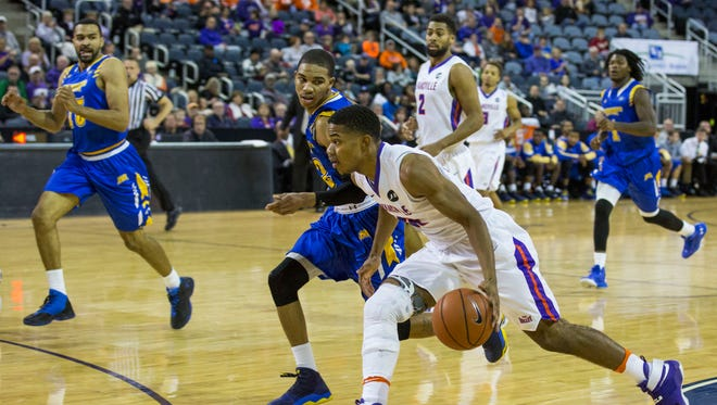 UE's Duane Gibson (25) dribbles past Morehead State players to drive the ball to the hoop during Saturday afternoon's game at the Ford Center.