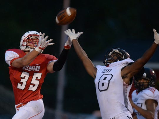 Richmond's Kobe Walker catches a pass in the endzone